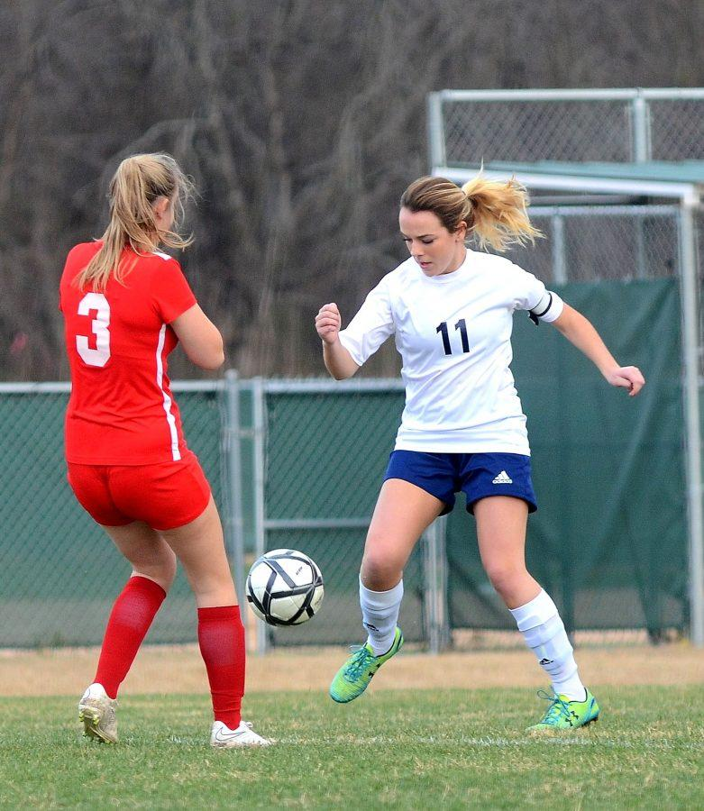 Senior captain Sarah Chinners dribbles around a First Baptist defender.  The Mustangs beat the Saints 5-0