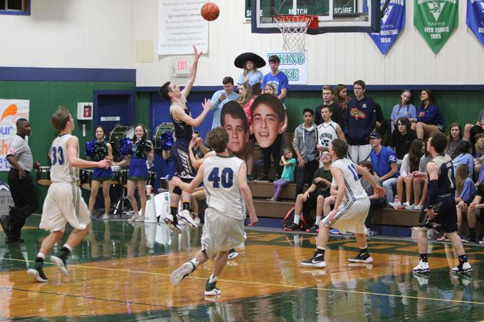 Junior, Adrian Hydock drives to the basketball for a layup during the matchup against Waco Vanguard