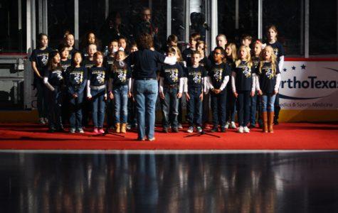 Honor Choir Sings at Allen American Hockey Game