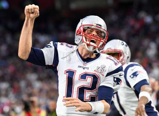 Tom Brady pumps his fist after a vital touchdown pass.