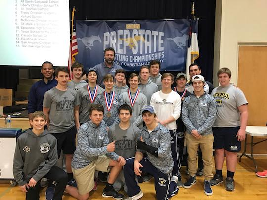 The McKinney Christian Wrestling Team gets together for a photo after a  successful tournament.