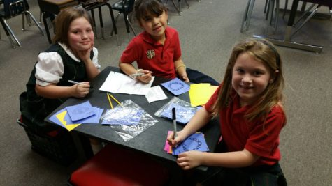 First grade students make Val-O-Grams to be sold during lunch.