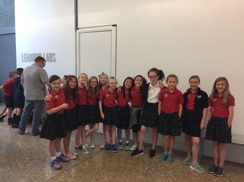 4th grade girls pause for a picture while on a field trip at the Perot Museum.