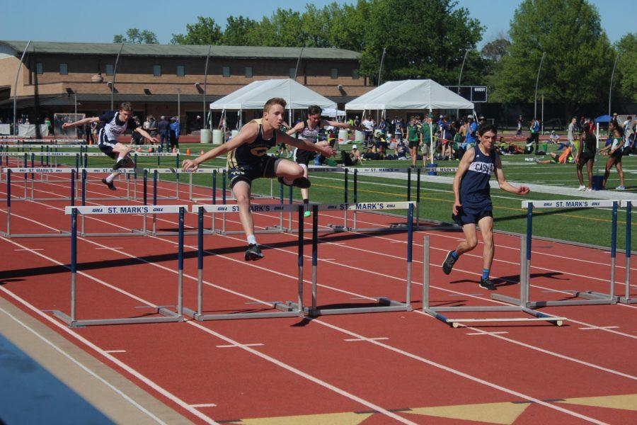Aaron+Phillips%2C+9th%2C+runs+the+100+meter+hurdles+at+St.+Marks.+