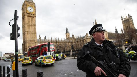 A British Law Enforcement personnel stands watch following the attack.