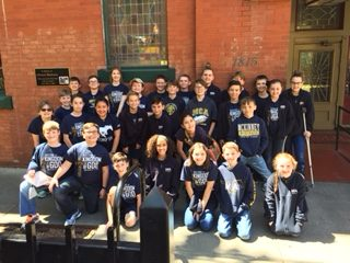The fifth grade students stop in front of the Spaghetti Warehouse to take a picture.