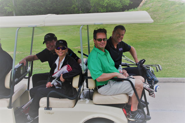 The Boyd team stops for a picture while on the golf course.