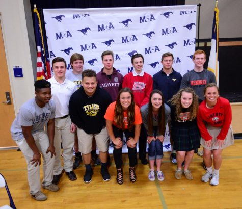 Signees took a group picture after signing their letter of intent.