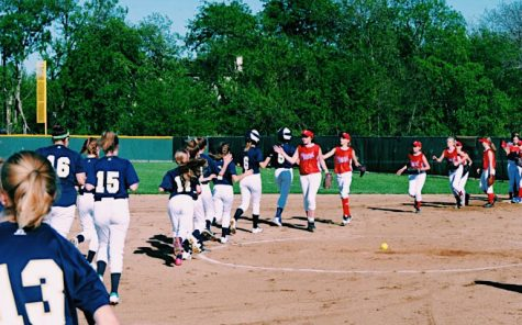 The girls shake hands after their last game of the season against Prince of Peace.