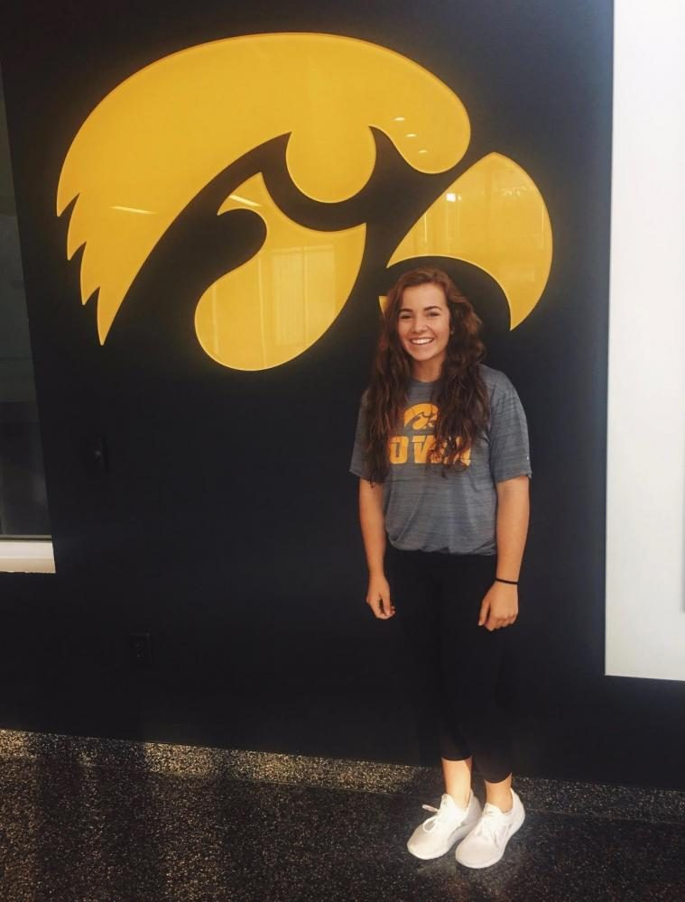Lowes stands in front of the University of Iowa Hawkeye during her official visit.