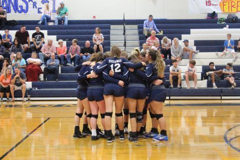 The JV girls gather for a pregame prayer and breakout into their first set against HSAA.