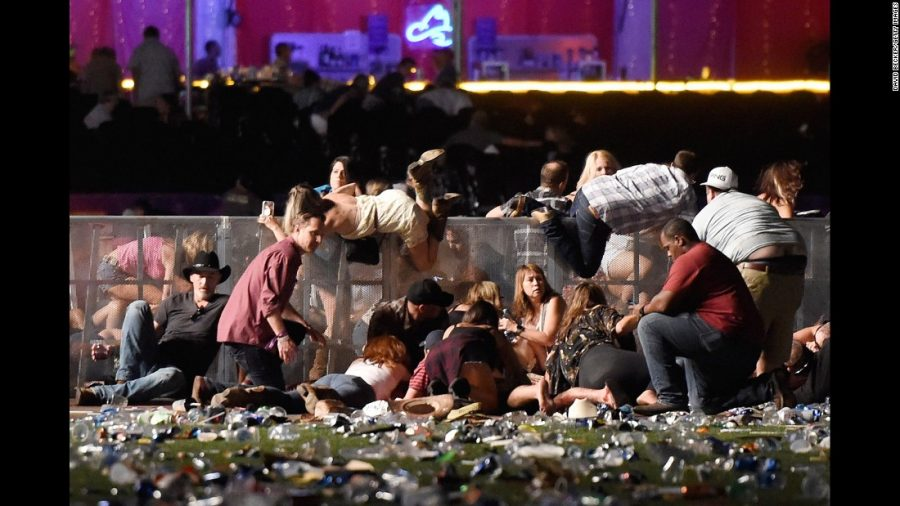 Panic is shown as people dive for cover during the Las Vegas shooting.