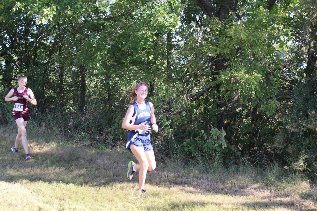Junior Scout Mayberry runs through the race trying to keep a positive attitude as she approaches the next hill.