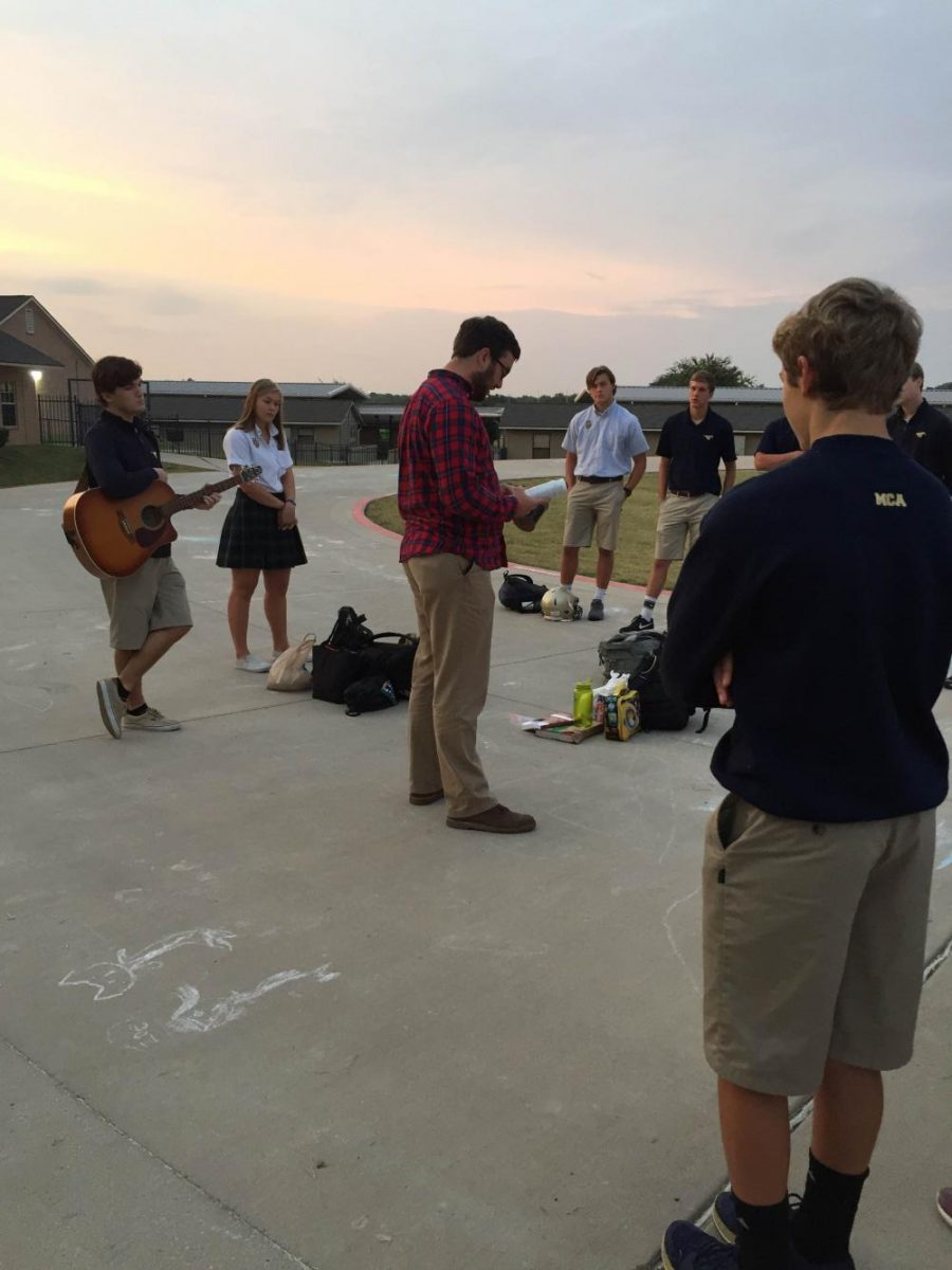 As the sun rises over the horizon, Pastor Trey and Upper School students gather together to pray with each other over their nation.