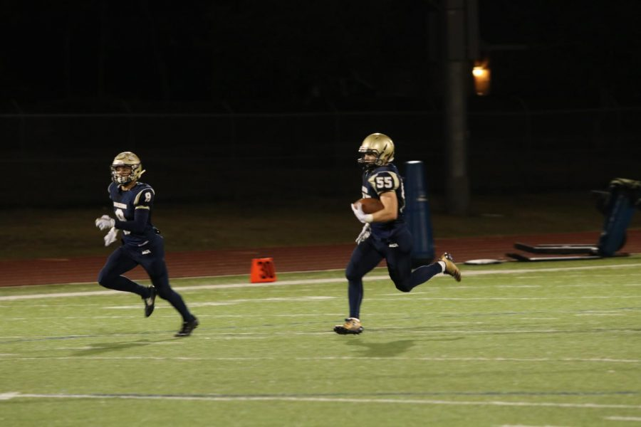 Senior Will Harrell returns a punt for a touchdown.