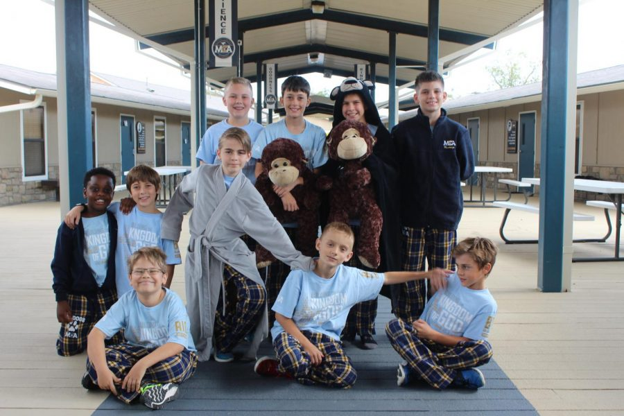 5th grade boys gather for a picture in their Big Dogz PJs.