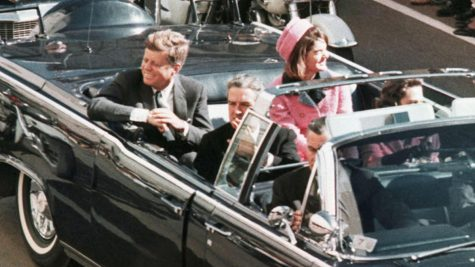 John Kennedy and his wife, Jackie Kennedy in the Dallas motorcade. This was taken moments before his death.