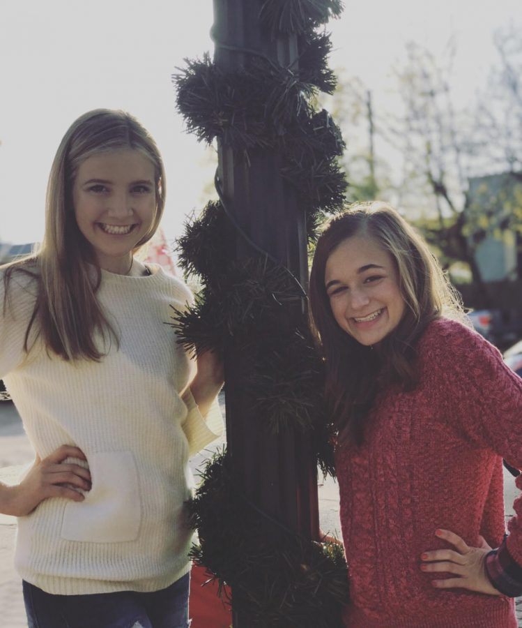 Freshman Olivia Proctor and Alessia Catullo pose for a picture at Home for the Holidays.