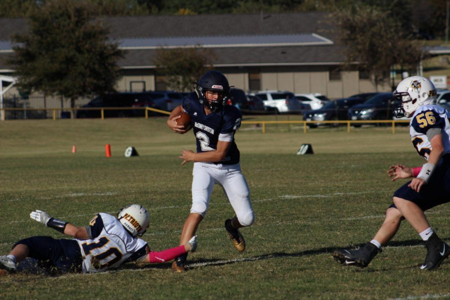 Cameron Mitton runs the ball for a large gain for the Mustangs.