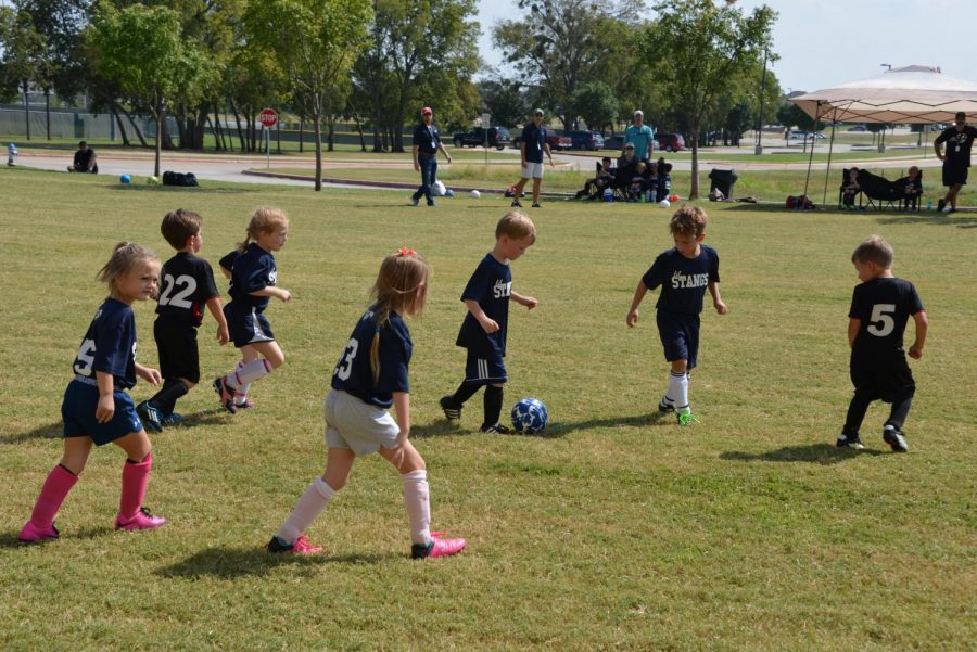 The Lil' Stangs take the ball upfield