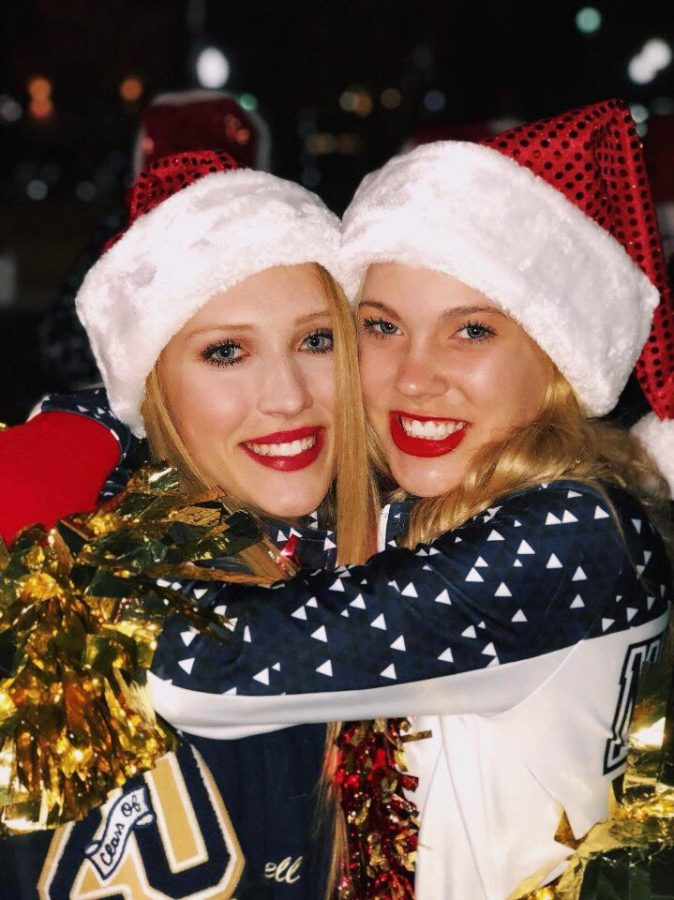 Meg Boone and Campbell Martin, 10th, pose for a picture during the christmas parade.
