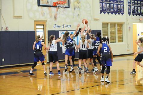 Eighth grader Karlene Shelton gets the rebound and is able to score a point for the Mustangs.