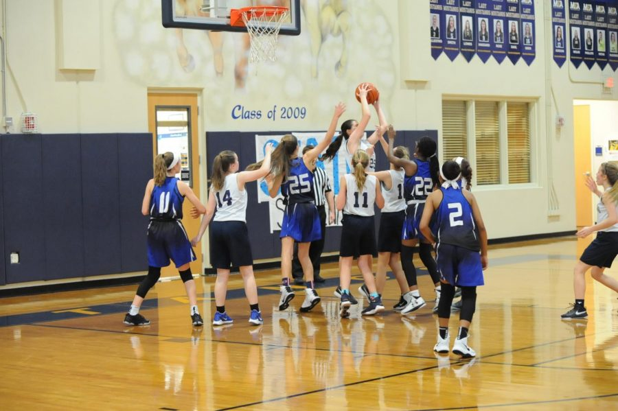 Eighth+grader+Karlene+Shelton+gets+the+rebound+and+is+able+to+score+a+point+for+the+Mustangs.