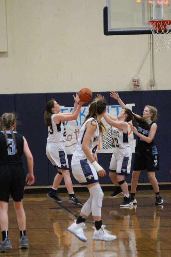 Sophomore Jolie Clow scores a layup in the game against reicher.