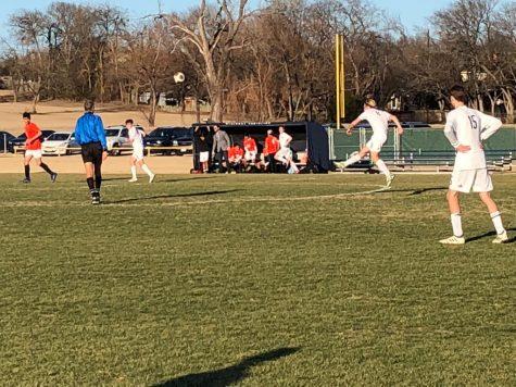 Senior guest player, Greg Newland shoots towards the Blazers goal.