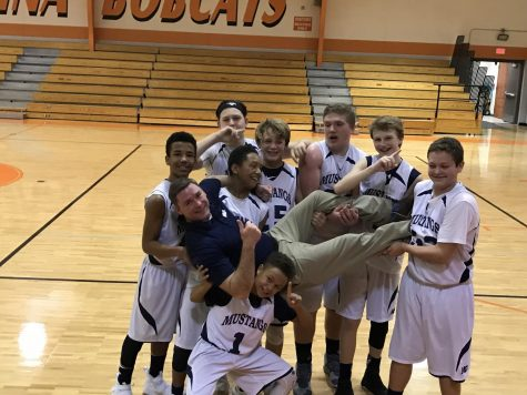 MS D1 Boys Basketball celebrates another win with Coach Wysong.