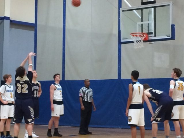 Mac Grimes shoots a free throw against Coram Deo in district play.
