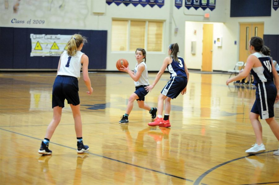 Eighth grader Maddie Clark   gets ready to pass the ball to seventh grader Georgia Haggard to get an open shot and an opportunity to score.