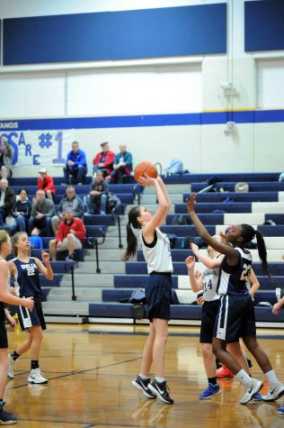 Eighth Grader, Karlene Shelton goes up to take a shot, resulting with a point for the Mustangs.