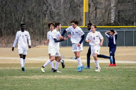 The Mustangs cheer after the ball was put into the back of the net.
