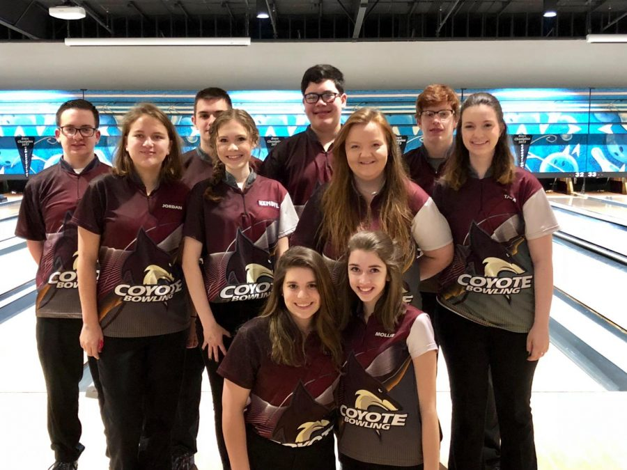 Sophomore Lydia Gilbert takes a picture with her bowling team after finishing third place at their tournament