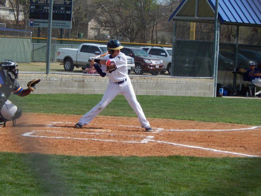 Sophomore Stone Knowles goes up to bat and hits a double.