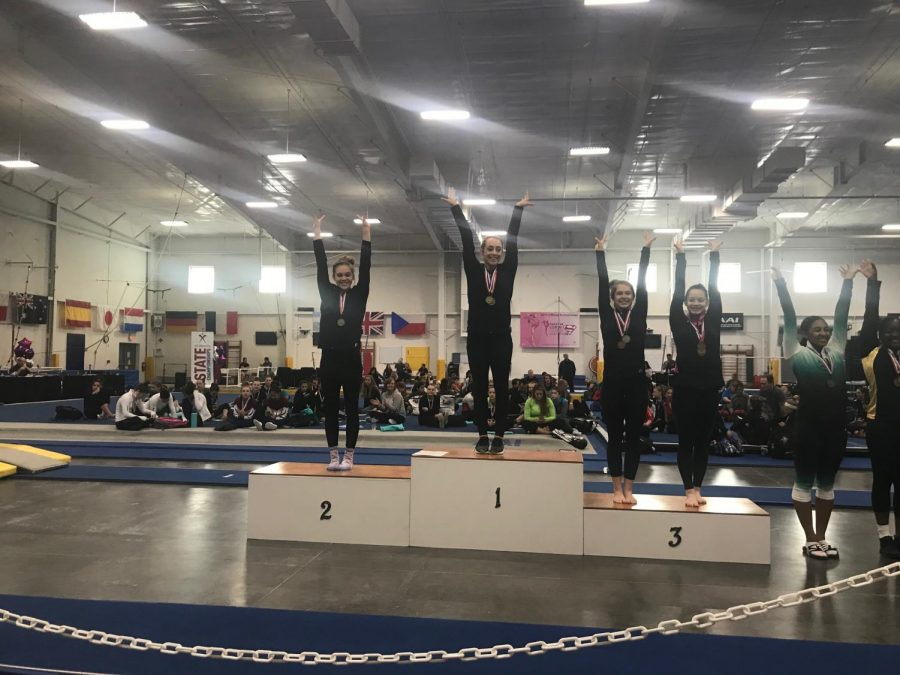 Sophomore Hannah Grubbs places second place in the balance beam competition