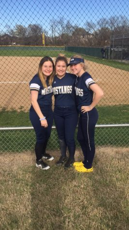 Juniors Kara Vita, Elizabeth Krusing, and Scout Mayberry pose for a picture after their district game.