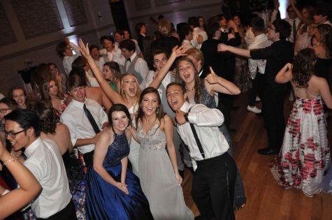 A group of Seniors get together for a fun picture at their last Prom.