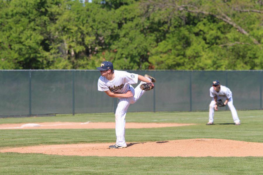 Senior Kyle Medders pitches against Vanguard.