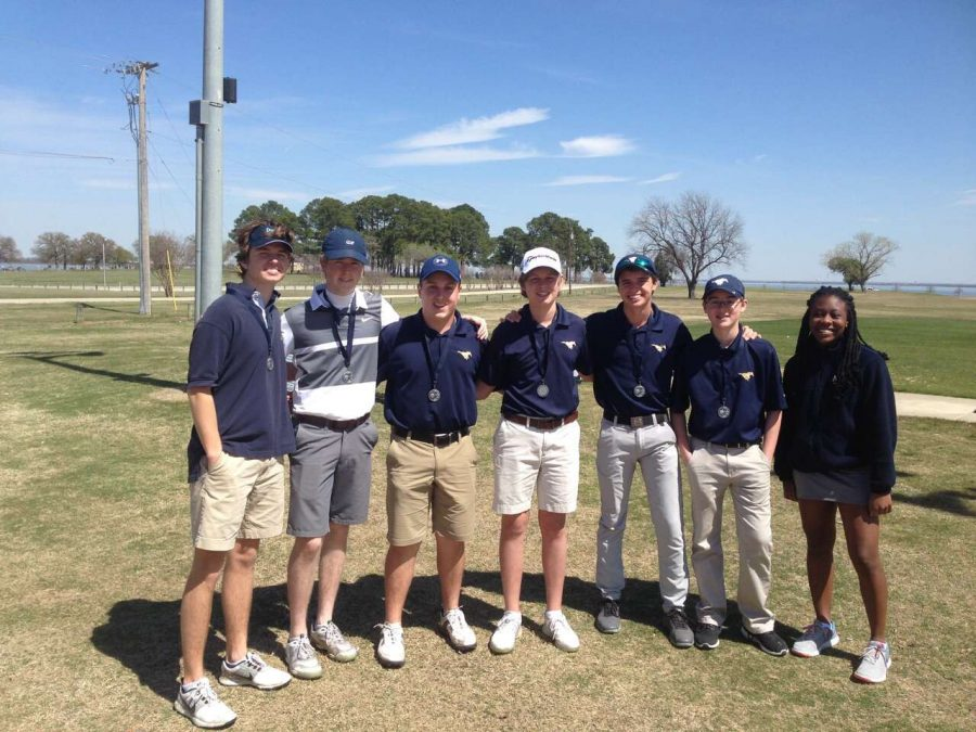 This years Varsity Golf team poses for a picture after their first tournament of the season.