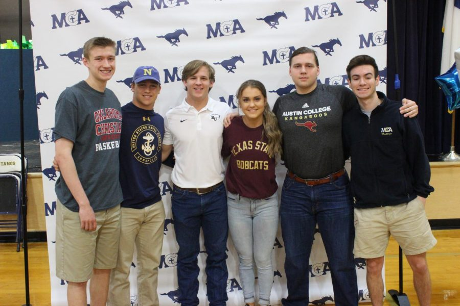 All six senior athletes sign their letter of intent to play college sports in chapel on Wednesday.