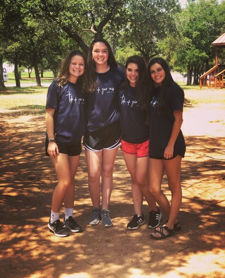 Juniors Emma Brant, Jolie Clow, Lydia Gilbert, and Maura Cueva pose for a picture before leaving retreat.