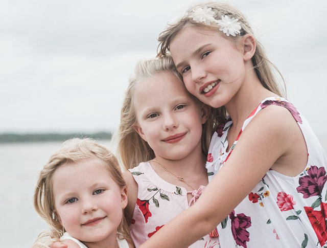 While vacationing in South Carolina, kindergartener Brynn, second grader Sophie, and fourth grader Carys Mejan enjoyed the beach at Seabrook Island.