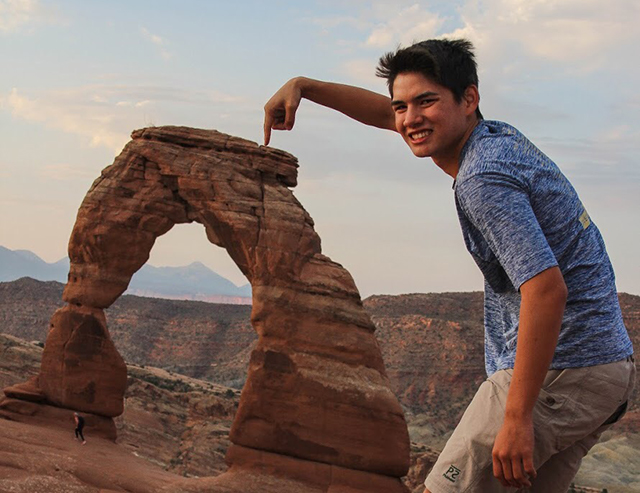 Senior Josh Wong takes a silly pic while visitng Arches National Park with his family.