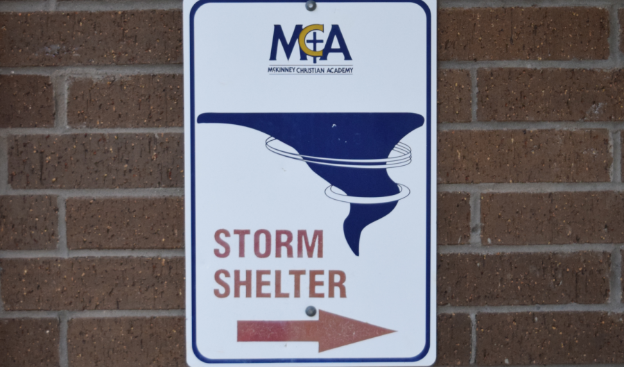 The+designated+tornado+shelter+is+in+%22The+Dungeon%22+underneath+the+SLC%2C+as+indicated+by+this+sign.+Once+each+semester%2C+the+entire+school+is+assembled+here+for+their+tornado+drill.