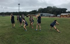 A few Cross Country girls warm up before their first race of the season at Sadler, it was quite muddy so the runners had to be extra prepared physically.