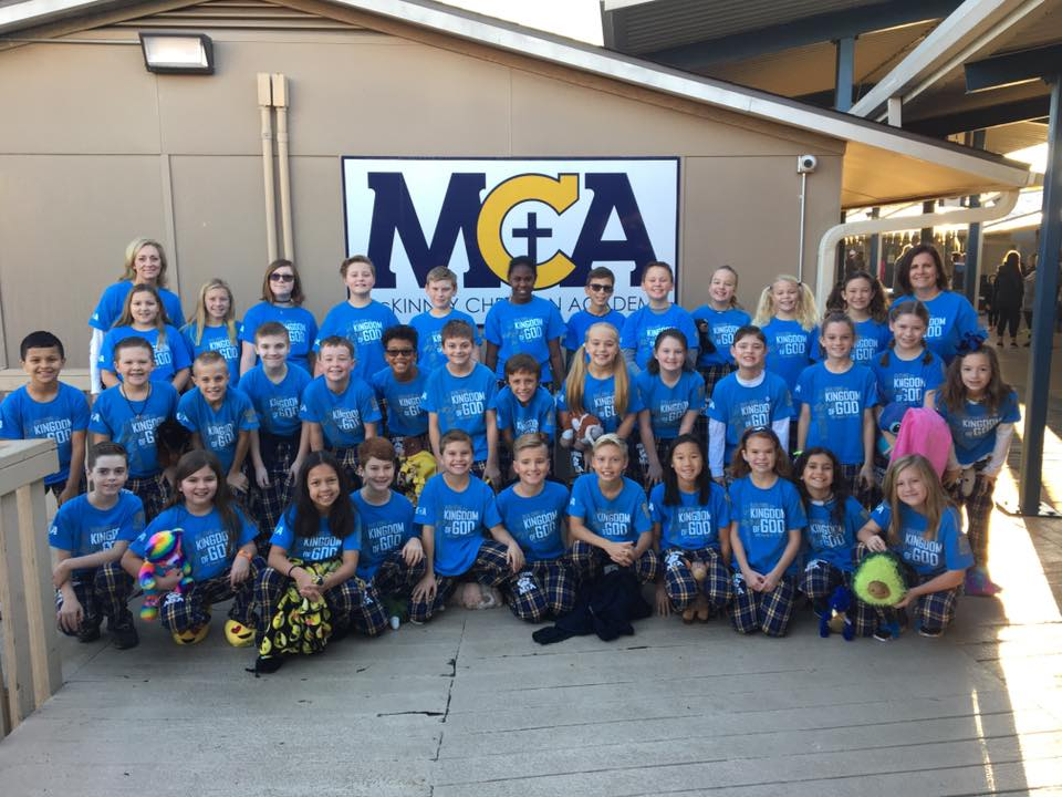 The 5th grade BigDogz pose for a class picture after parading down the deck on Pajama Day.