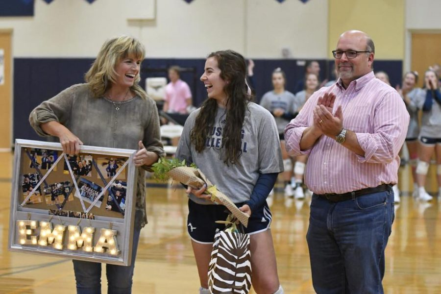 Senior+Emma+Lowes+laughs+with+her+family+as+she+is+recognized+at+senior+night.