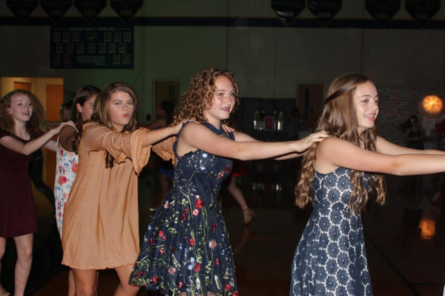 The Middle School girls danced in a train to one of the songs.